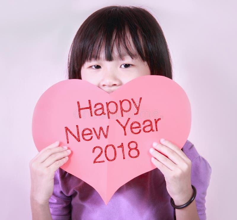 红色心脏形状卡片与新年好2018年 库存照片