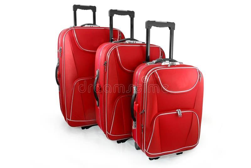 红色手提箱三旅行 免版税库存照片