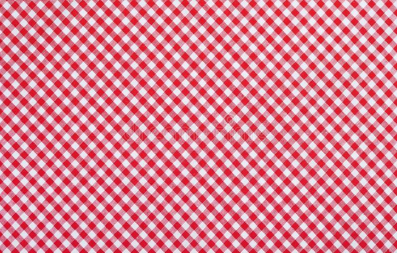 红色方格的织品 库存照片