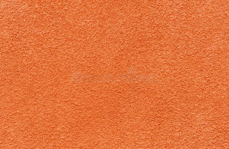 红色条纹的灰泥墙壁纹理 库存图片