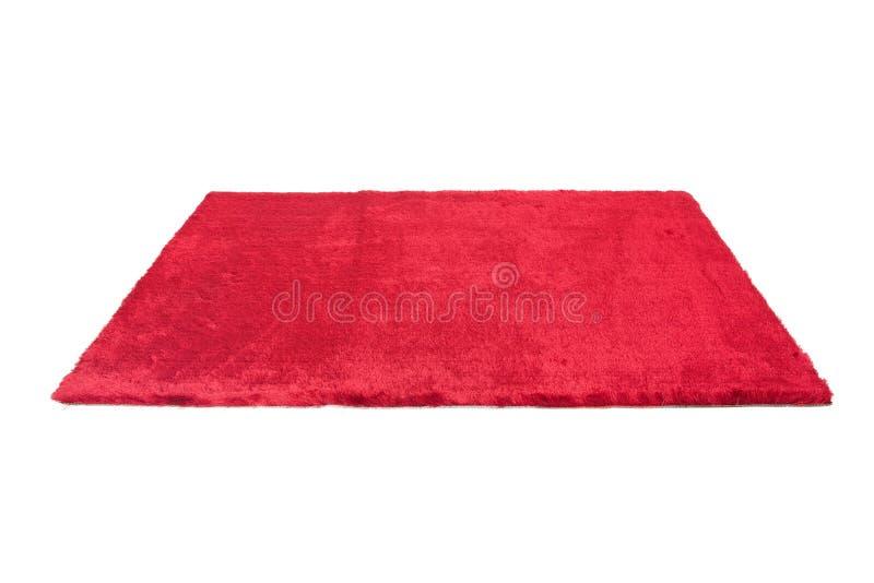 红色毛茸的地毯 查出 免版税库存照片