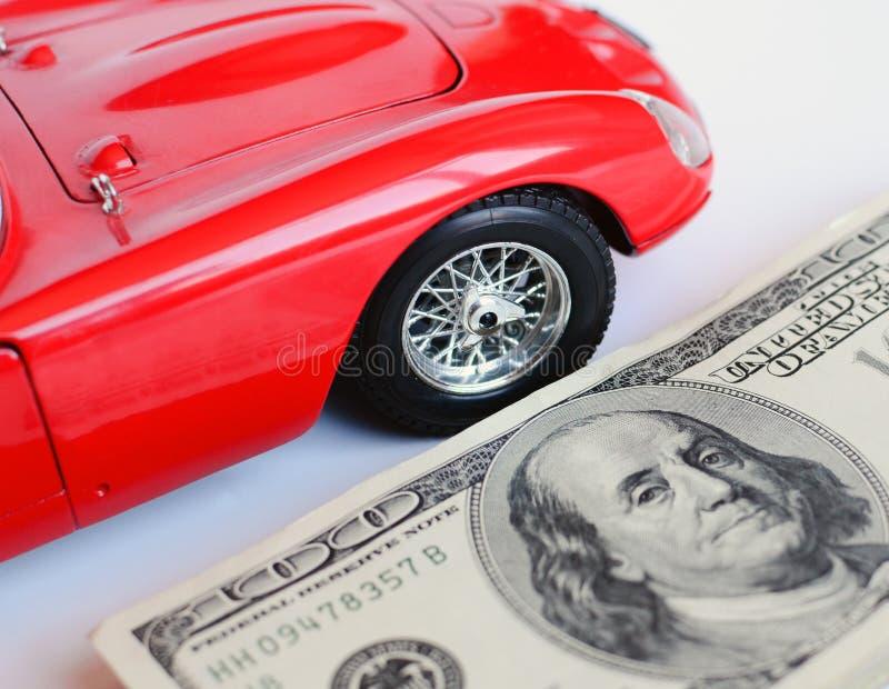 红色汽车和金钱 库存照片