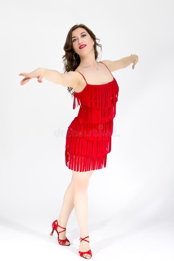 红色流动的拉丁礼服的女性舞厅舞蹈家 库存照片