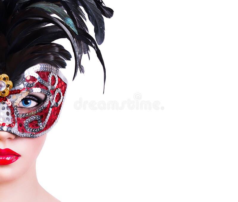 红色狂欢节面具的美丽的女孩 免版税库存图片