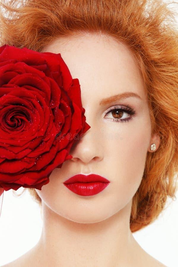 红色玫瑰色妇女 免版税库存照片