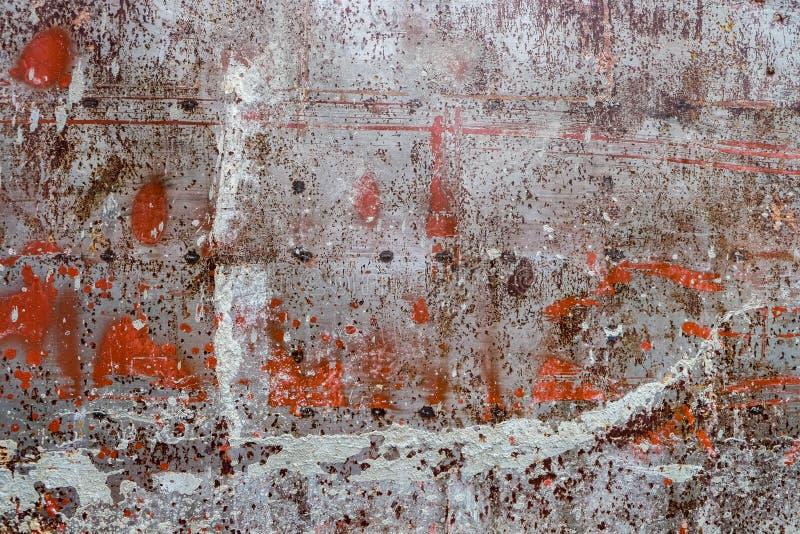 红色生锈的银色金属墙壁关闭 库存照片
