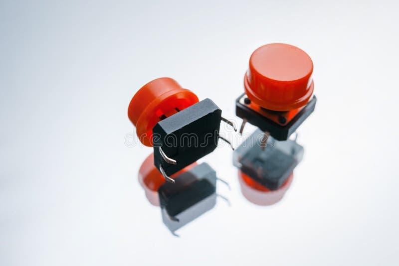 红色电子按钮元素开关 免版税库存照片