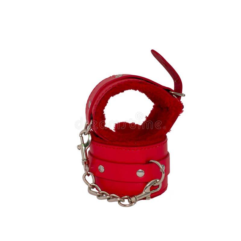 红色皮革手铐在白色背景中 库存图片