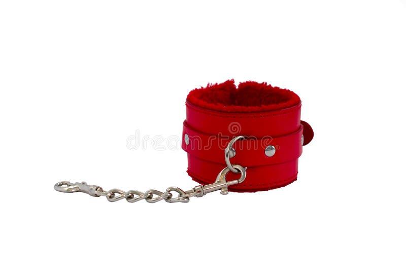 红色皮革手铐在白色背景中 图库摄影