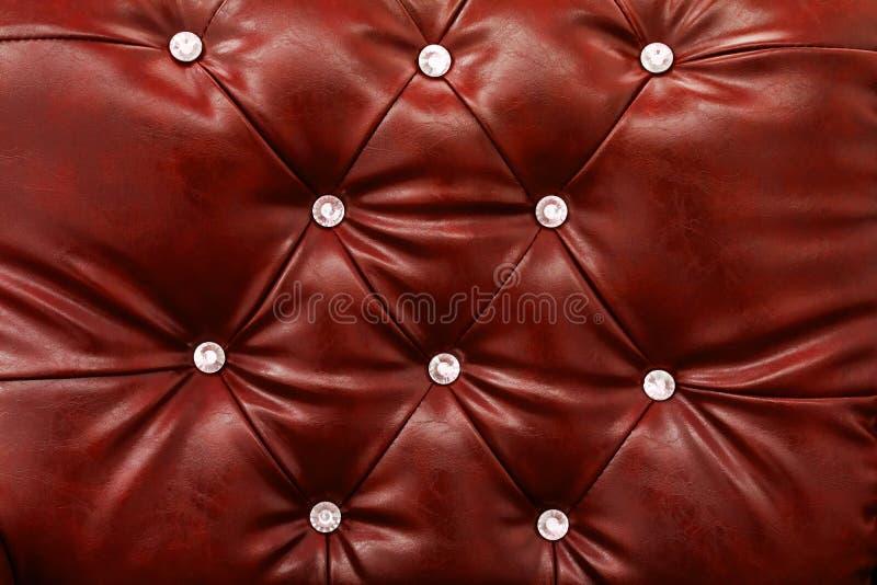 红色皮革沙发纹理背景 免版税库存照片