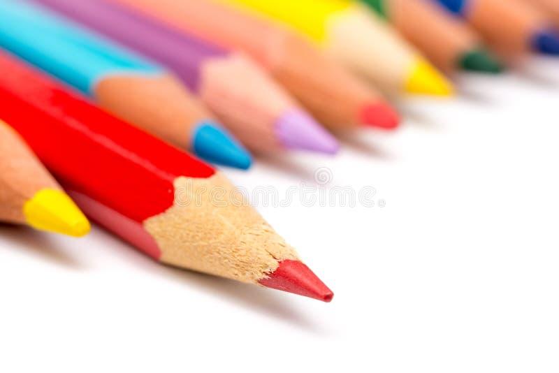 红色着色铅笔提高 免版税库存照片
