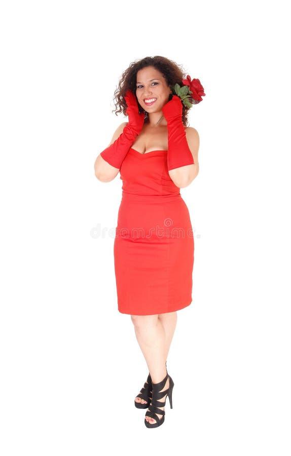 红色礼服和红色丁香的妇女 免版税库存照片