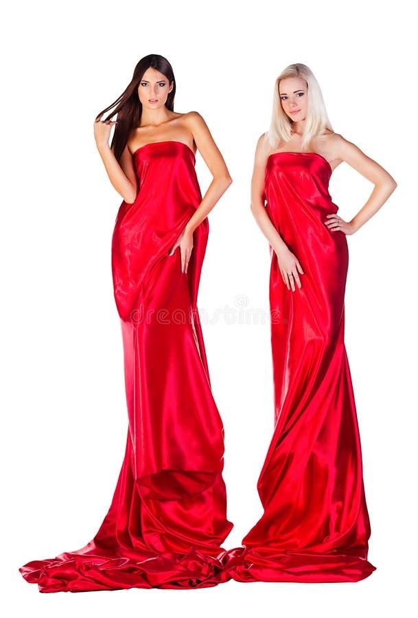红色礼服的两名妇女 图库摄影