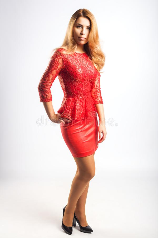 红色礼服的夫人 免版税图库摄影