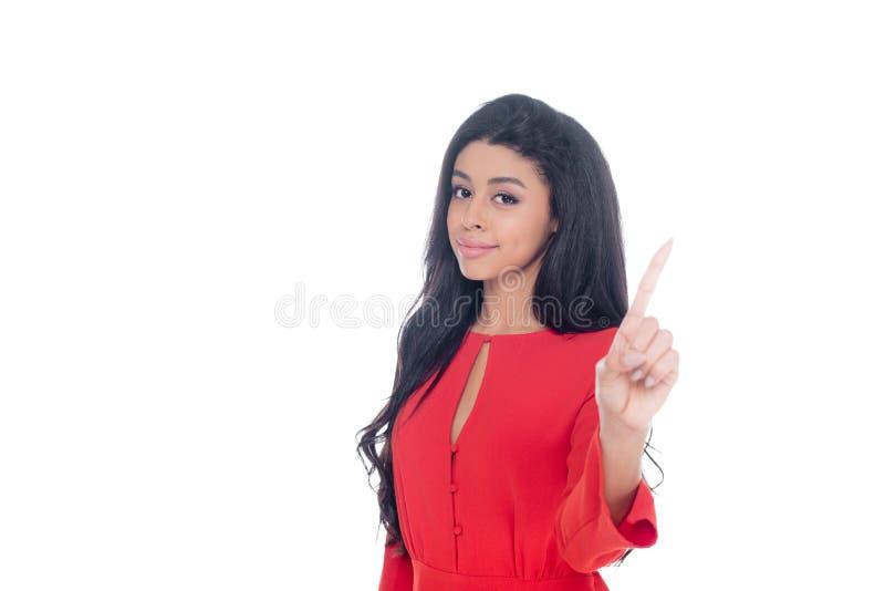 红色礼服的非裔美国人的女孩打手势由手指的被隔绝 库存照片