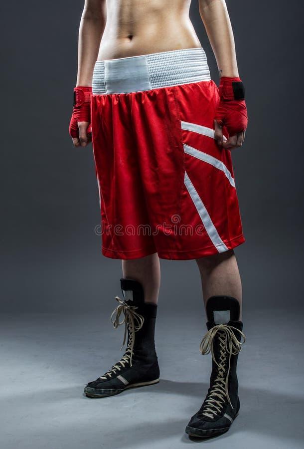 红色礼服的,细节照片拳击妇女 免版税图库摄影