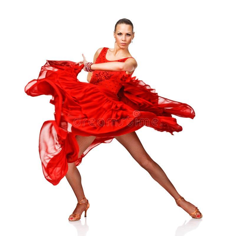 红色礼服的年轻和可爱的拉丁美州的女孩 库存照片