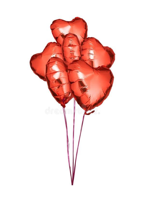 红色箔迅速增加与心脏形状  免版税库存照片