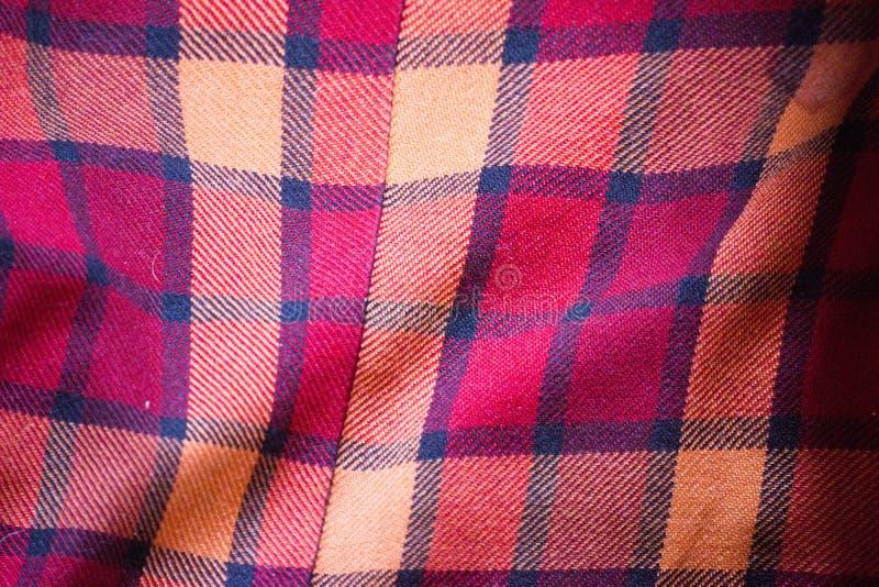 红色羊毛格子花呢披肩织品的纹理 库存图片