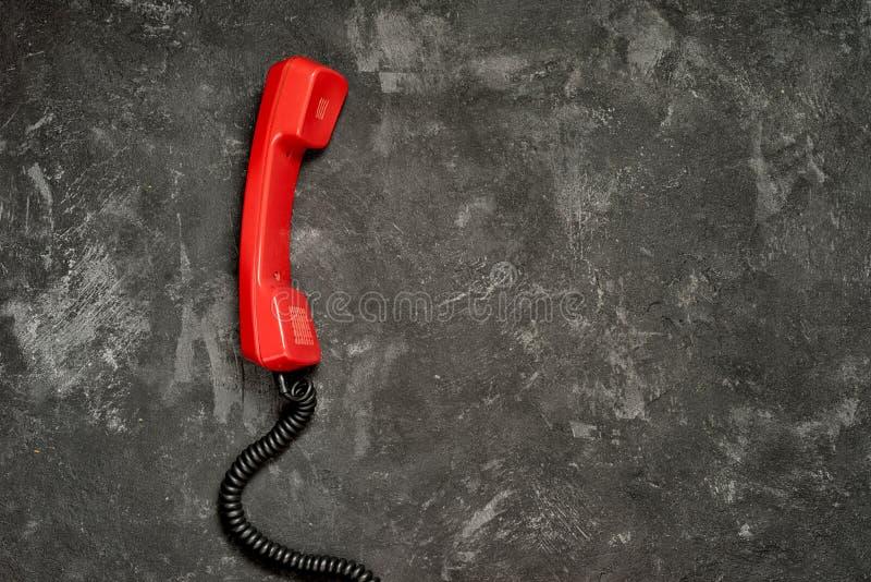 红色老电话手机 库存照片