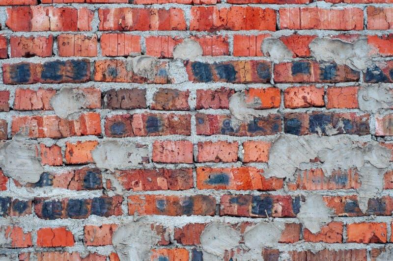 红色老被佩带的砖墙纹理背景 免版税库存图片
