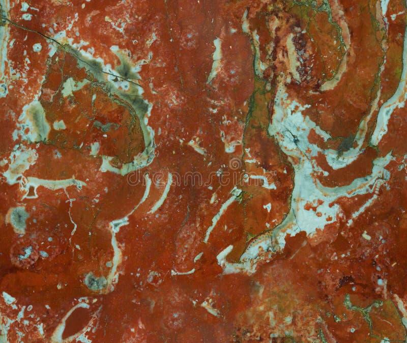 红色自然无缝的大理石石纹理样式背景 与c的概略的自然石无缝的大理石纹理结构表面 库存图片