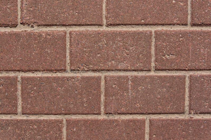 红色花岗岩砖墙壁  库存照片