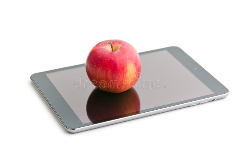 红色苹果和计算机片剂 库存图片