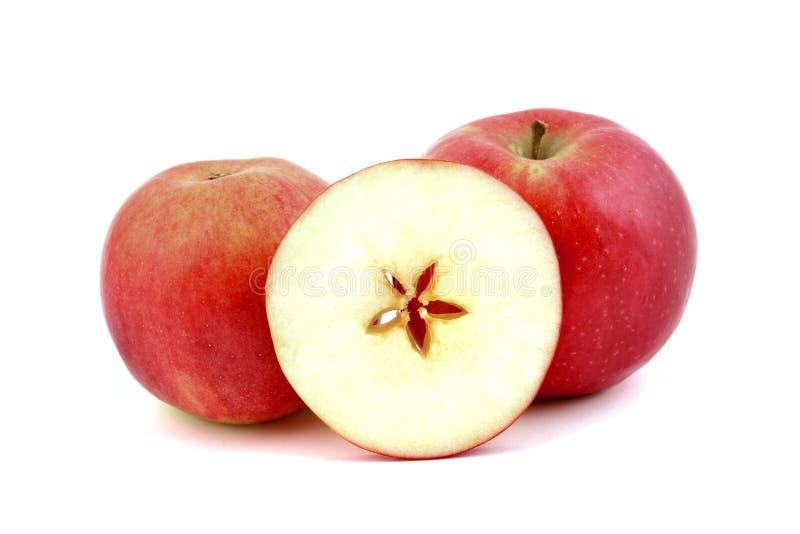 红色苹果,心脏的,在白色 图库摄影
