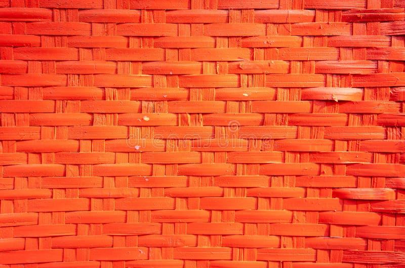 红色被编织的或织法秸杆纹理背景 篮子模式无缝的织法 免版税库存照片