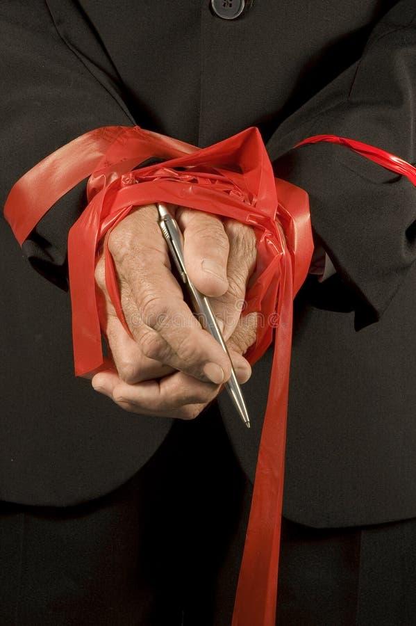 红色被缠结的磁带 免版税库存照片