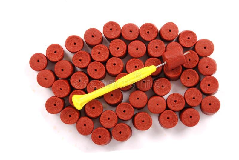 红色被预演练的大比目鱼药丸 库存图片