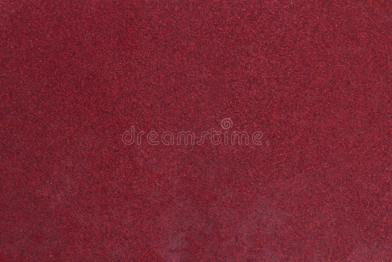 红色质感粗糙的沙纸背景 库存照片