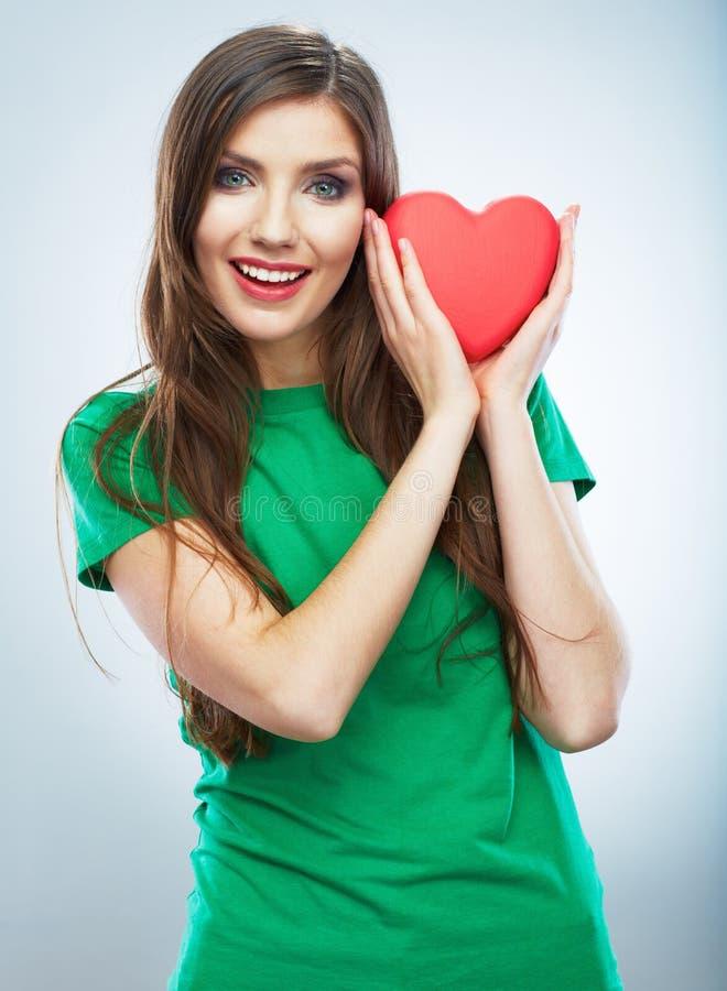红色重点 背景爱红色玫瑰色符号白色 美好的妇女举行Valent画象  免版税库存图片