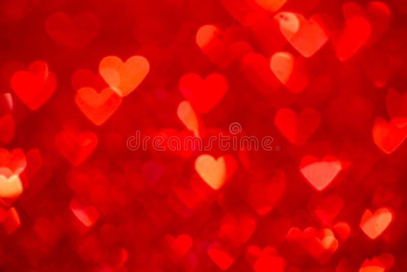 红色重点bokeh背景 情人节纹理 免版税库存照片