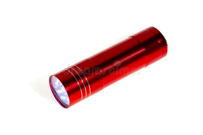 红色铝LED手电,隔绝在白色 特写镜头 库存照片