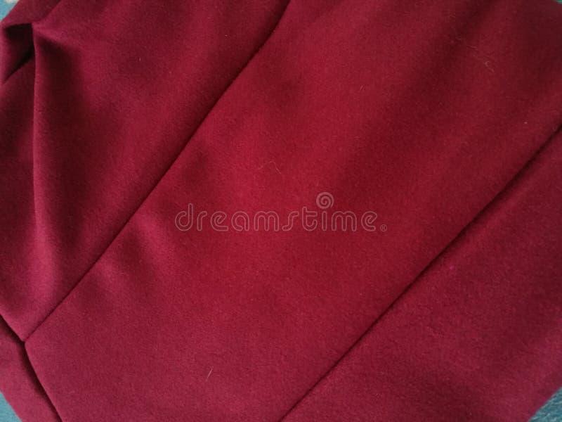 红色风衣服 库存图片