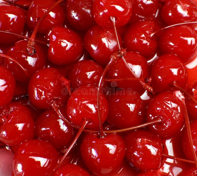 红色鸡尾酒酒浸樱桃欢乐背景  库存照片
