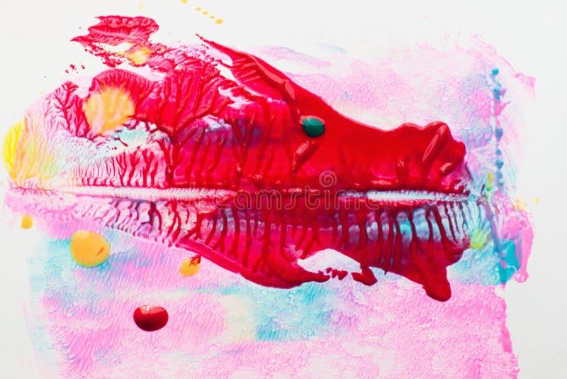 红色龙的图片在五颜六色的背景的 库存照片