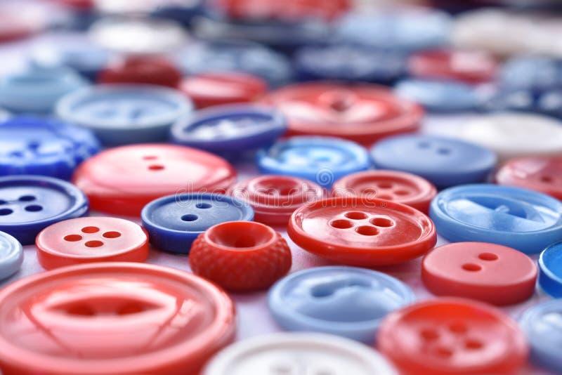 红色,白色和蓝色缝合的按钮 图库摄影