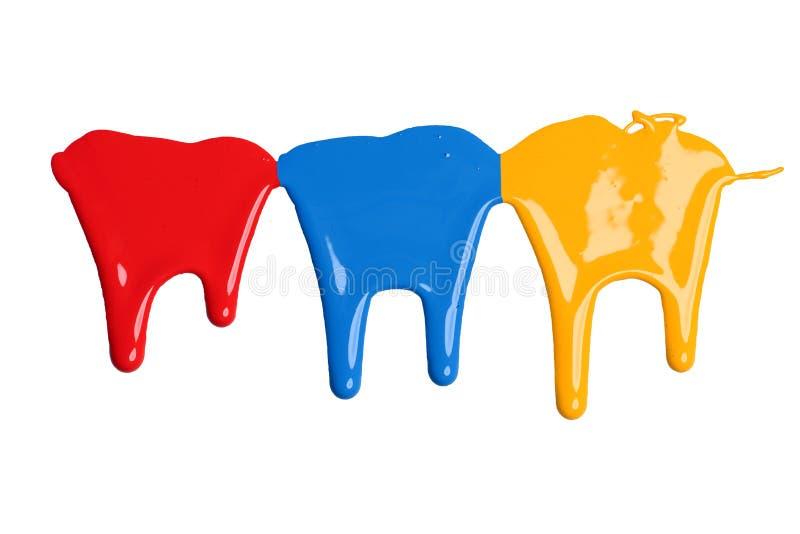 红色,蓝色和黄色油漆水滴 免版税库存照片