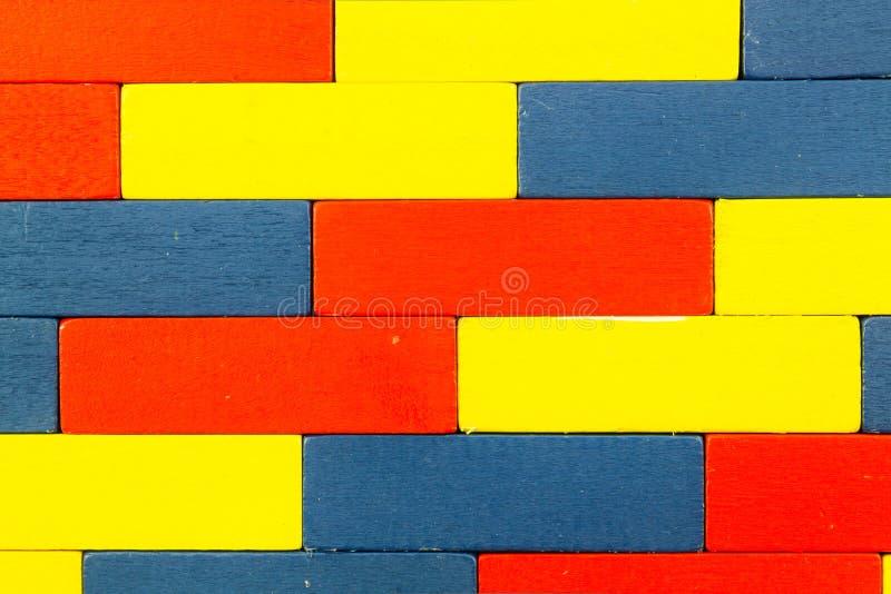 红色,蓝色,黄色木玩具 免版税库存照片