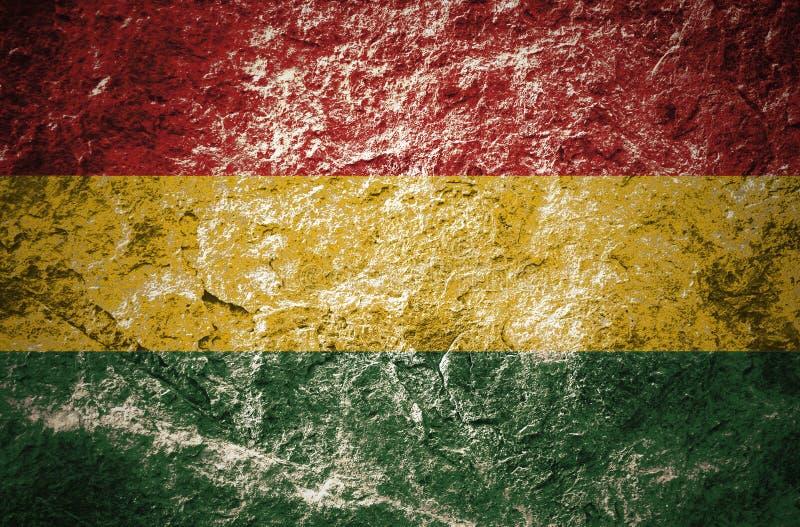 红色,黄色,绿色,雷鬼摇摆乐的在石墙上的颜色样式 免版税库存图片
