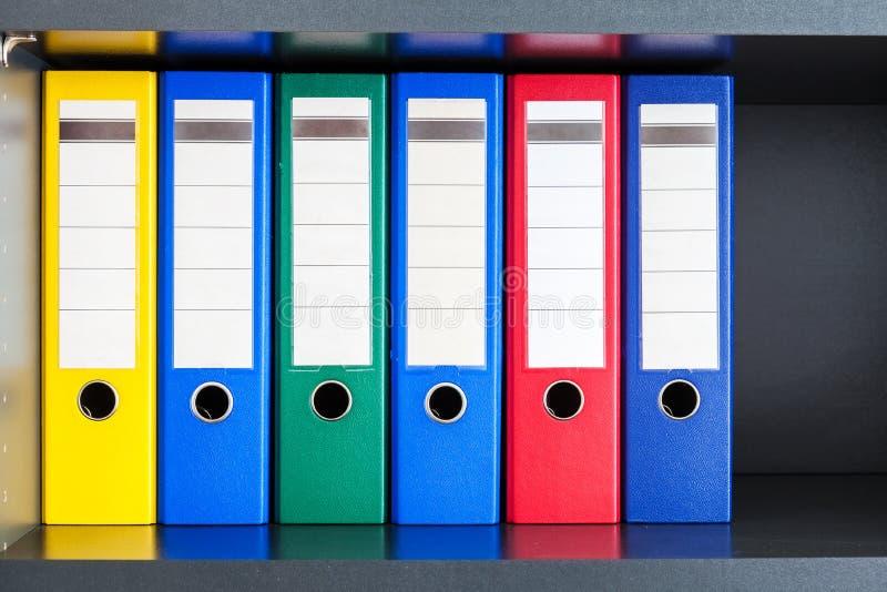 红色,绿色,蓝色和黄色办公室文件夹 图库摄影