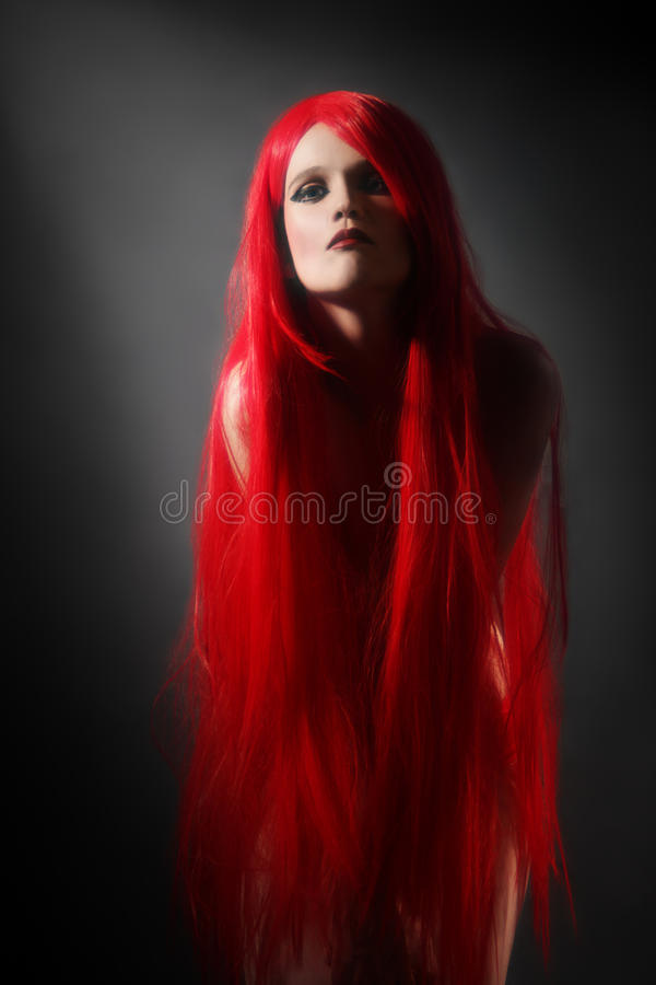 红色头发妇女发型 免版税库存图片