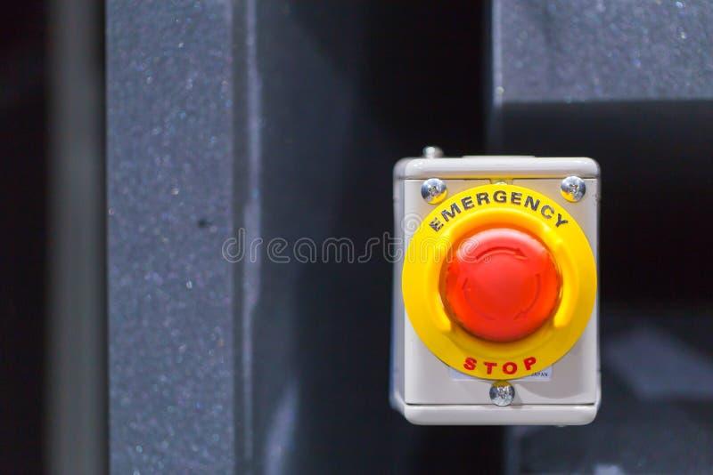 红色紧急按钮或停止键手新闻的 工业机器的停止键 免版税库存图片
