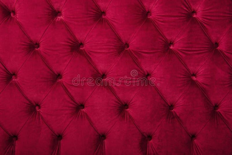 红色capitone装缨球织品室内装饰品纹理 免版税库存图片