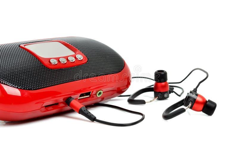 红色MP3和耳机 免版税库存图片