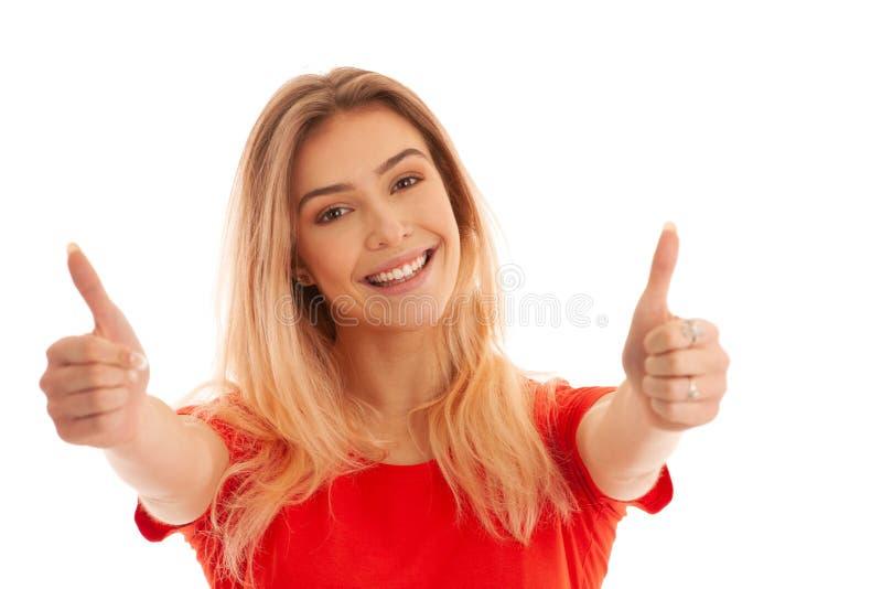 红色T恤杉姿态成功的美丽的年轻女人与陈列赞许被隔绝在白色 图库摄影