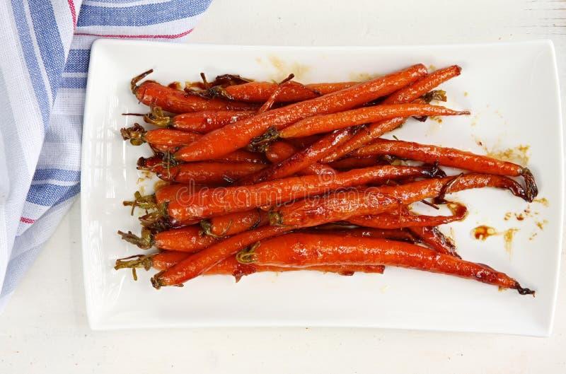 红萝卜给蜂蜜上釉 免版税库存图片